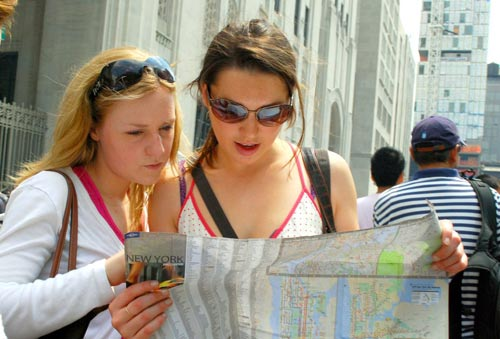 Two_girls_reading_map_of_NY